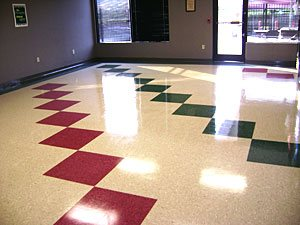 the recently cleaned tile floor of an office