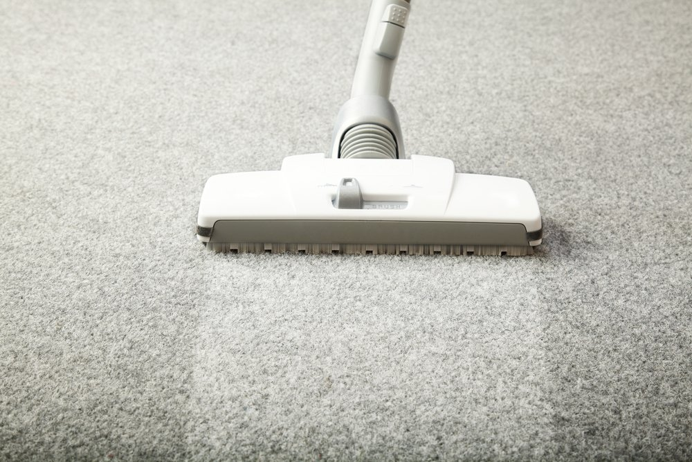 vacuuming a clean carpet